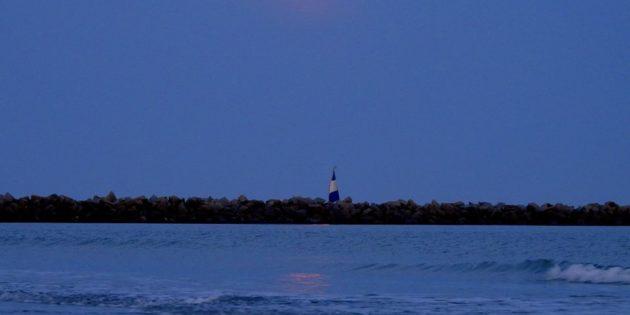 Bela Noite enluarada em Praia do Cassino e molhes da barra