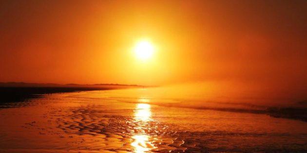 Sol Nascendo Forte na Maior Praia do Mundo
